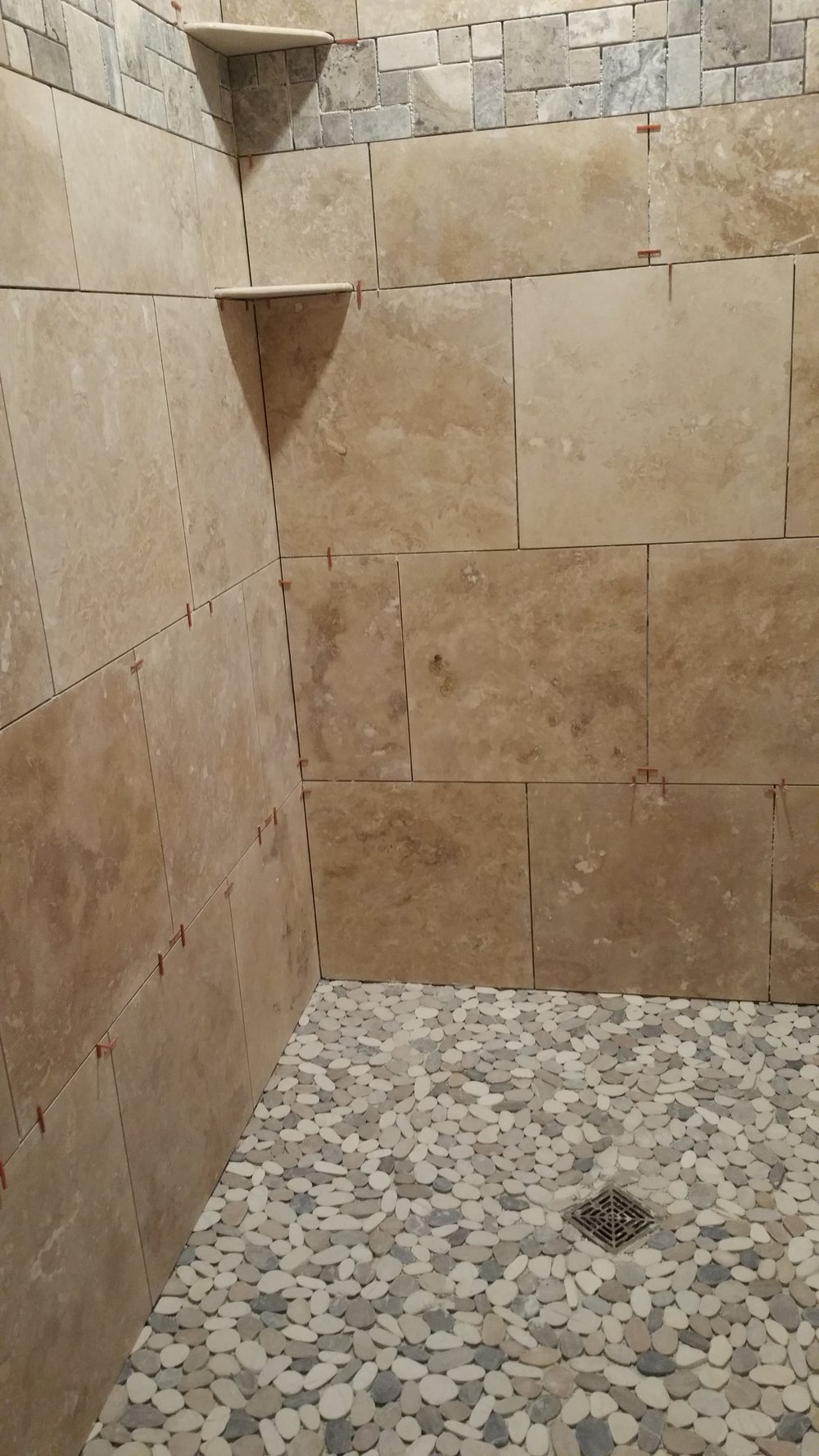Tarvertine Shower with Schluter Ditra for waterproofing, sealed tile twice after finishing