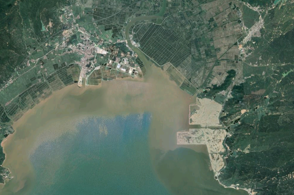 This aerial photo gives a sense of scale of the project we are reimagining as a new ecological coastline on the South China Sea in Taishan. The perimeter of the reclamation area (pictured right) is approximately 20 linear kilometers (12 linear miles) and will be the site of a new city in the future. The dark green grid pattern along the coastline to the North shows the fish farms and agricultural areas beyond. Our project will be a considerable improvement over what is typically a hard edged sea wall. The future can respond to sea level rise with biodiverse habitats and occupiable waterfronts. For many years China has been buying Hong Kong's construction waste. Like Hong Kong, the vast majority of this waste has been used for land reclamation. China is a large country but it lacks arable farmland, therefore many of its new coastal cities are built on reclaimed land to preserve the hinterland for agriculture. In its new environmental push, China has now stopped buying Hong Kong's construction waste and has put a moratorium on further reclamation projects. This reclamation site is all built from HK construction waste mixed with gravel and rock. If you look closely you can see evidence of this in tiles, rebar, etc. Hong Kong remains responsible for this waste to a degree and its interface with the ocean and coast.
