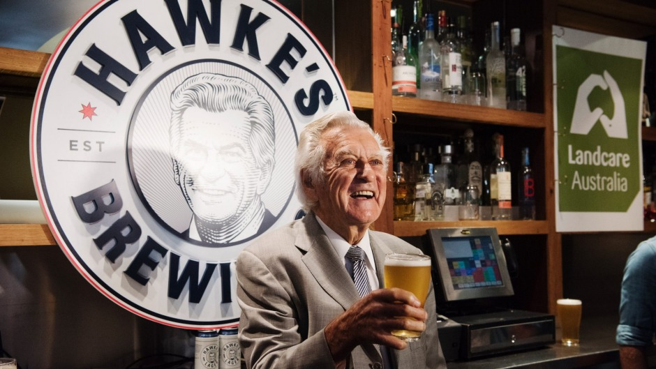 Bob Hawke pours a glass of his namesake brew. Photo: James Brickwood via Fairfax Media.