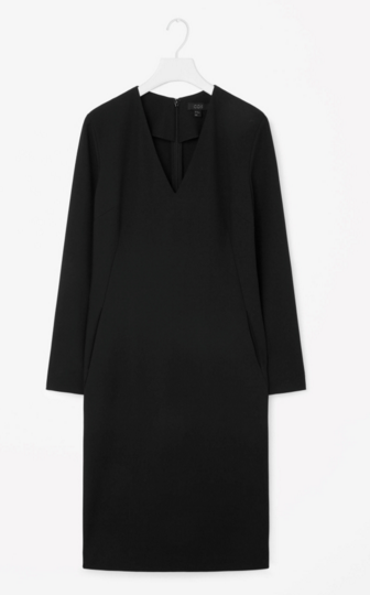 Fitted V-neck dress in black, 55 euro. Midi length, long sleeves, V-neck. Team with a polo when it's cold, dress it up with sparkling finery for evening wear.