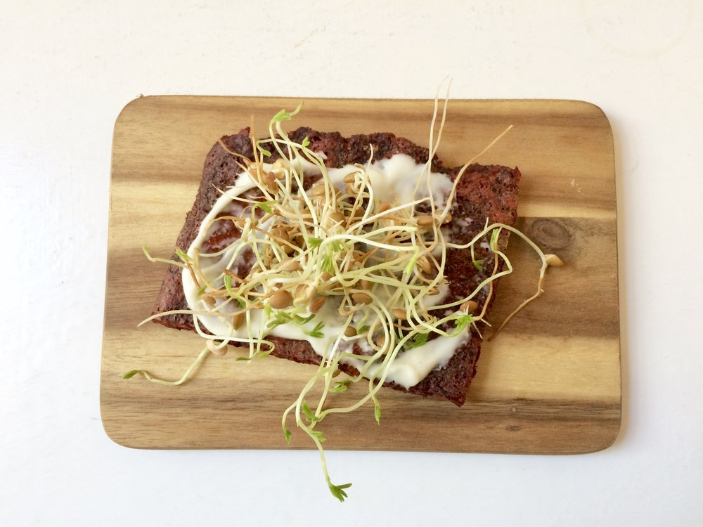Beetroot flatbread with home made mayo and lentil sprouts