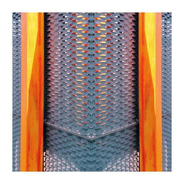 Locked in. #orange #steel #symmetry #vscocam (at El Poble Nou, Barcelona)