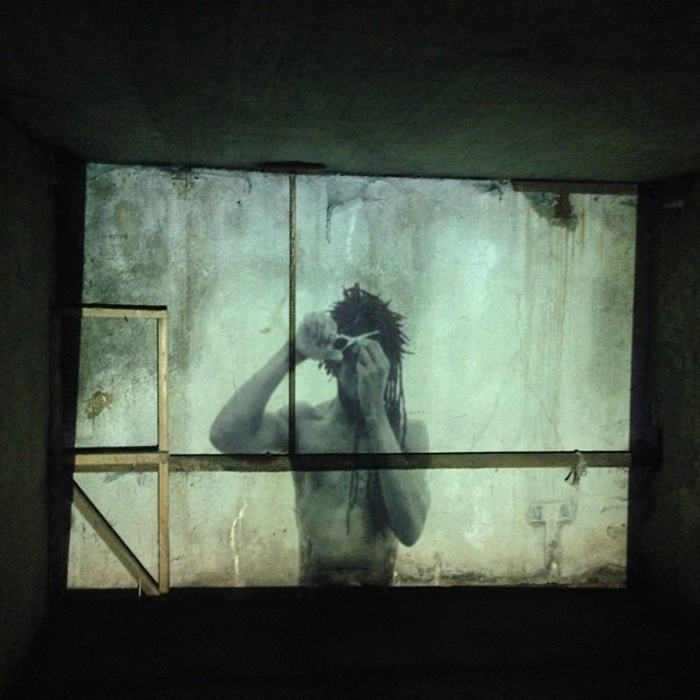 A still from our #installation with @yacobrobinson @outlinefestival #outlinefestival #film #selfportrait #art #selfie #shortfilm #projection #light #blackandwhite #ruins #moscow #russia #hair #haircut #dreadlocks #skin