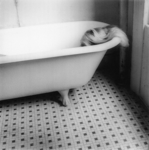 "It is never about the tools: believermag: SFMOMA hosts the first Francesca Woodman retrospective in the United States in more than two decades. It runs until February 20th and explores the complex body of work produced by the young artist before her suicide at age 22. Carmen Winant talks with the show's curator, Corey Keller. The full interview will run online in mid-March, when the show travels to the Guggenehim in New York. THE BELIEVER: I assume the fact of Woodman's suicide was impossible for you to avoid, as a curator. Do you feel that her premature death informs the reading of her work as inherently tortured?  COREY KELLER: There is obviously no way to avoid her suicide, but I have chosen not to focus on it. When you write a history, you know how it ends, and it inflects the way you read the beginning. Because of the particulars of this story, and the shortness of it, it has a way of casting a pall over all of the work. I have heard someone describe her images of ""Sloan in the Bathtub"" as referencing a coffin. But I've talked to many of her friends, and the one thing that came across from all of them is is that they don't recognize the person that people tell those stories about. Each person described Francesca as whimsical, quirky, fragile — and needing taking care of, perhaps — but not depressive or sad. All of them talk about how funny she was, and when she worked, how it was madcap, imaginative flights of fancy.  BLVR: How did she actually take the self-portraits? I don't think I've seen a release in her images; I assume she used a self -timer? CK: In some cases there is a release, but not very often. Sometimes she had a friend focus and snap the image, and sometimes she used a self-timer. I believe it is a combination of the three. BLVR: I've taught photography to college students, and without fail at least half of the group name Woodman as a towering influence. I'm interesed in her effect on young, contemporary female photographers. CK: Woodman's appeal to me seems obvious: Here is a young woman who took the simplest and most available of subjects — herself — and turned it into an incredible body of work. And she received international recognition. That must feel incredibly appealing to an art student. She worked with basic, close-at-hand materials, and to great effect. She has a powerful self-confidence in her work and a maturity in her vision. When speaking to one of her old New York friends, I asked if they went to galleries often together. She replied that they did, but not to look at other people's art. They went so Francesca could show her work. She was an ambitious young woman and a hard worker with an understanding of self-promotion. Francesca was not naive."