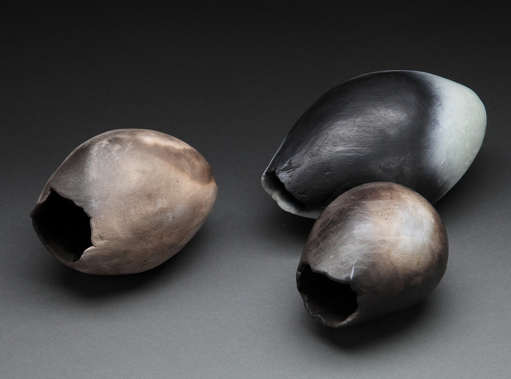 "Small Pods , 2015     3""-5"" x 6""-10""     pit fired clay"