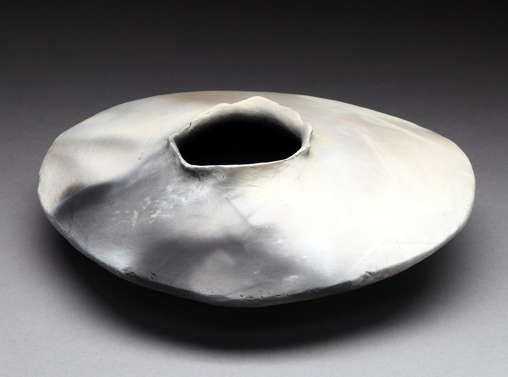 "Small Grey Hueco , 2013     4"" x 10"" x 10""     pit fired clay"