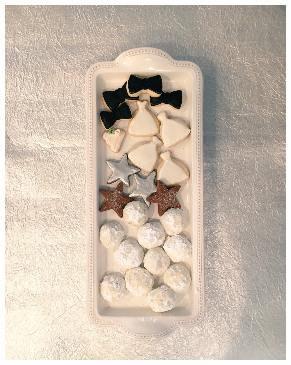 Miniature cookies. Perfect for little hands! Featured: sugar, chocolate french shortbread, and wedding tea cookies.