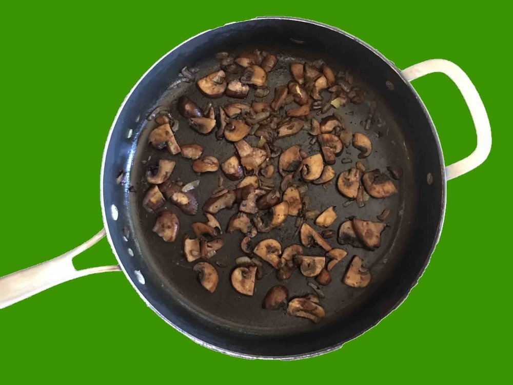 Add olive oil and butter to a large frying pan and heat over medium heat.  Add onions and cook for 2 minutes.  Add mushrooms and cook for 10 minutes.