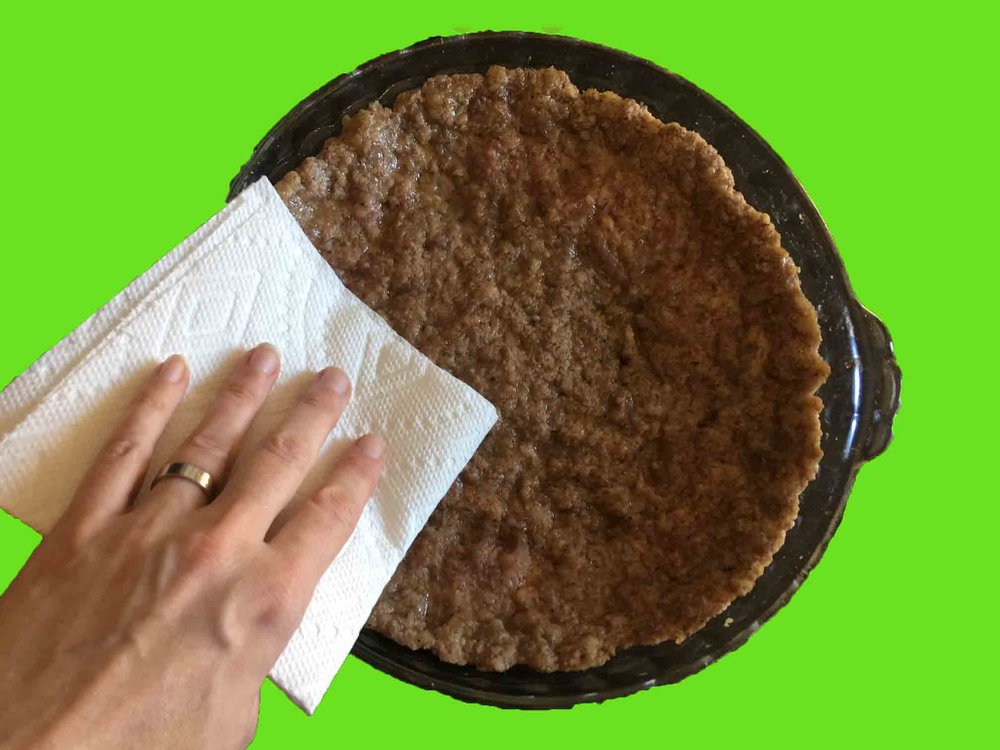 Bake the crust for 6-8 minutes until browned all over.  Pat the grease away with a paper towel.