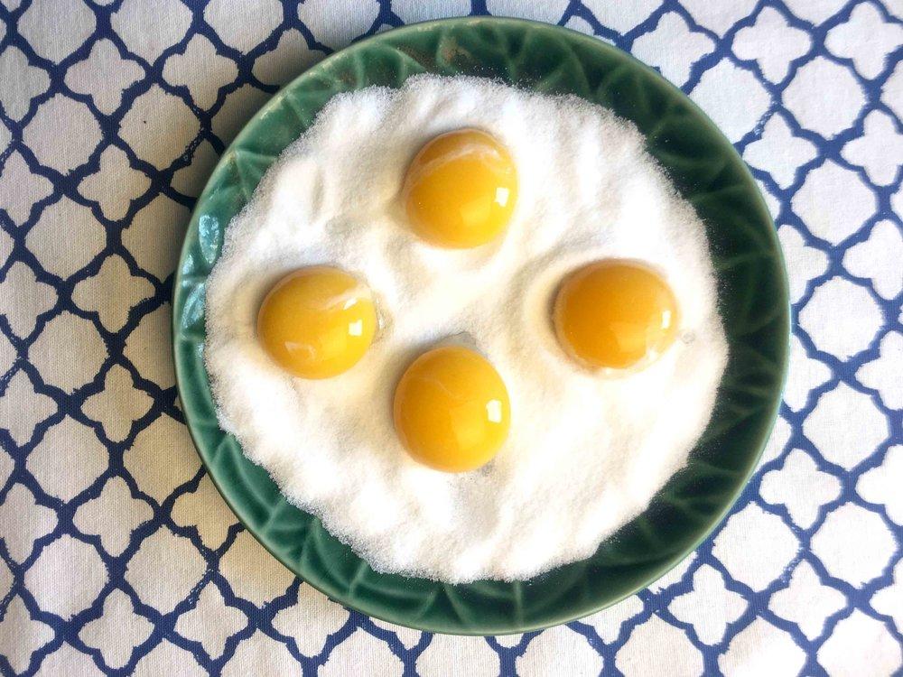 Add an egg yolk to each indentation.