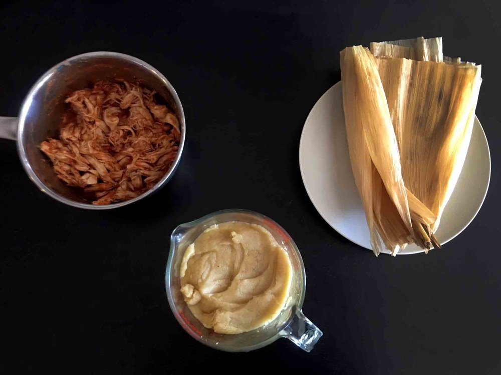 Gather your ingredients: softened corn husks, pulled chicken and almond flour masa harina.