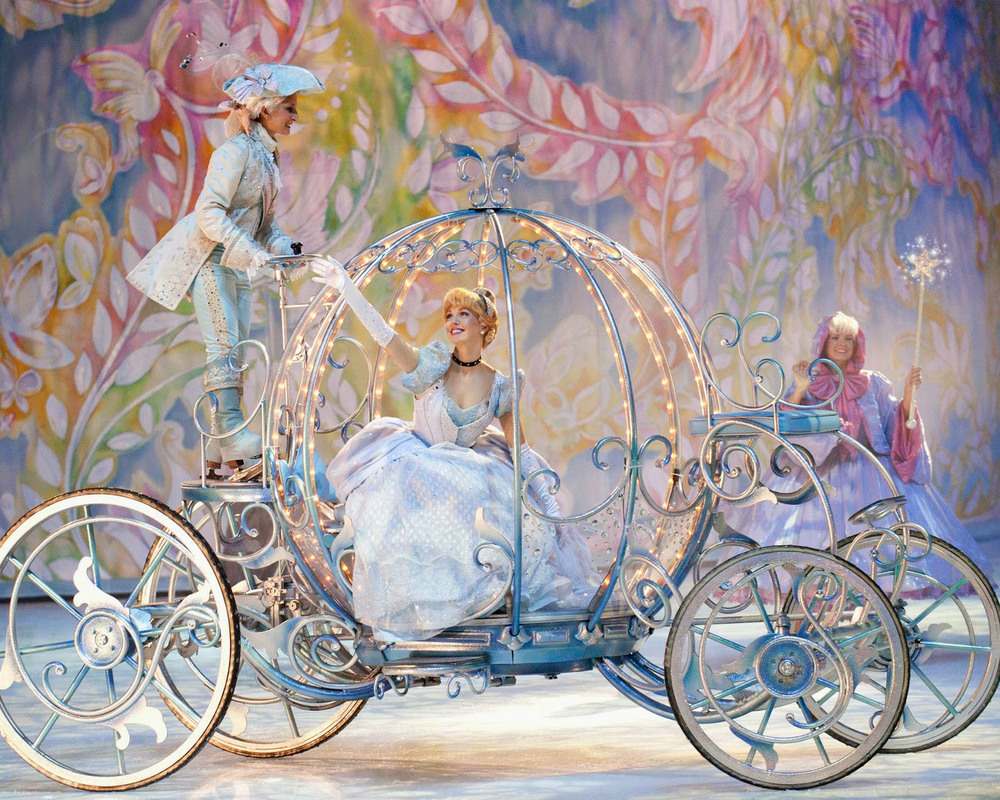 Cinderella and her Coach in front of the closed whimsically painted curvilinear screens.