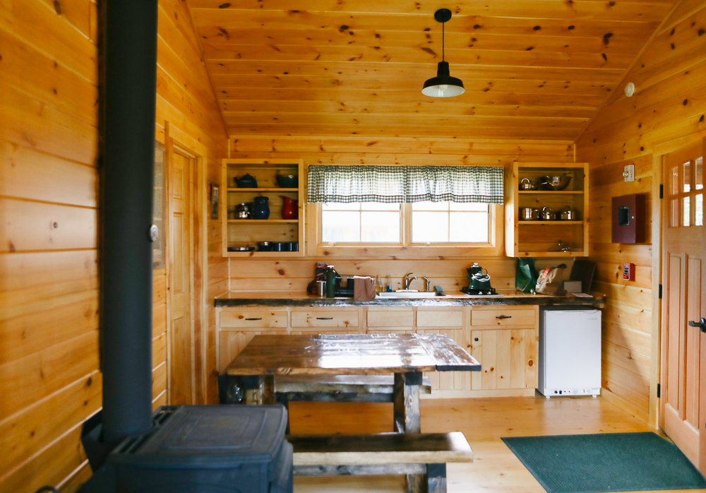 Our cabin's kitchen. Fully loaded with enamelware!