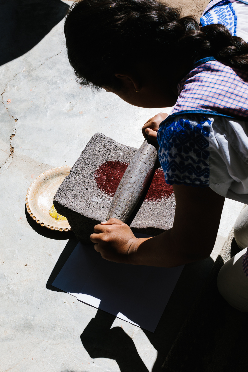 Cochineal on the metate being ground for natural dyeing.