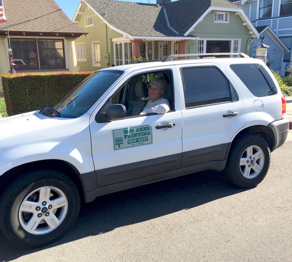 Bob in his hybrid Ford Escape cruising around town, coordinating work with crews and meeting with customers!