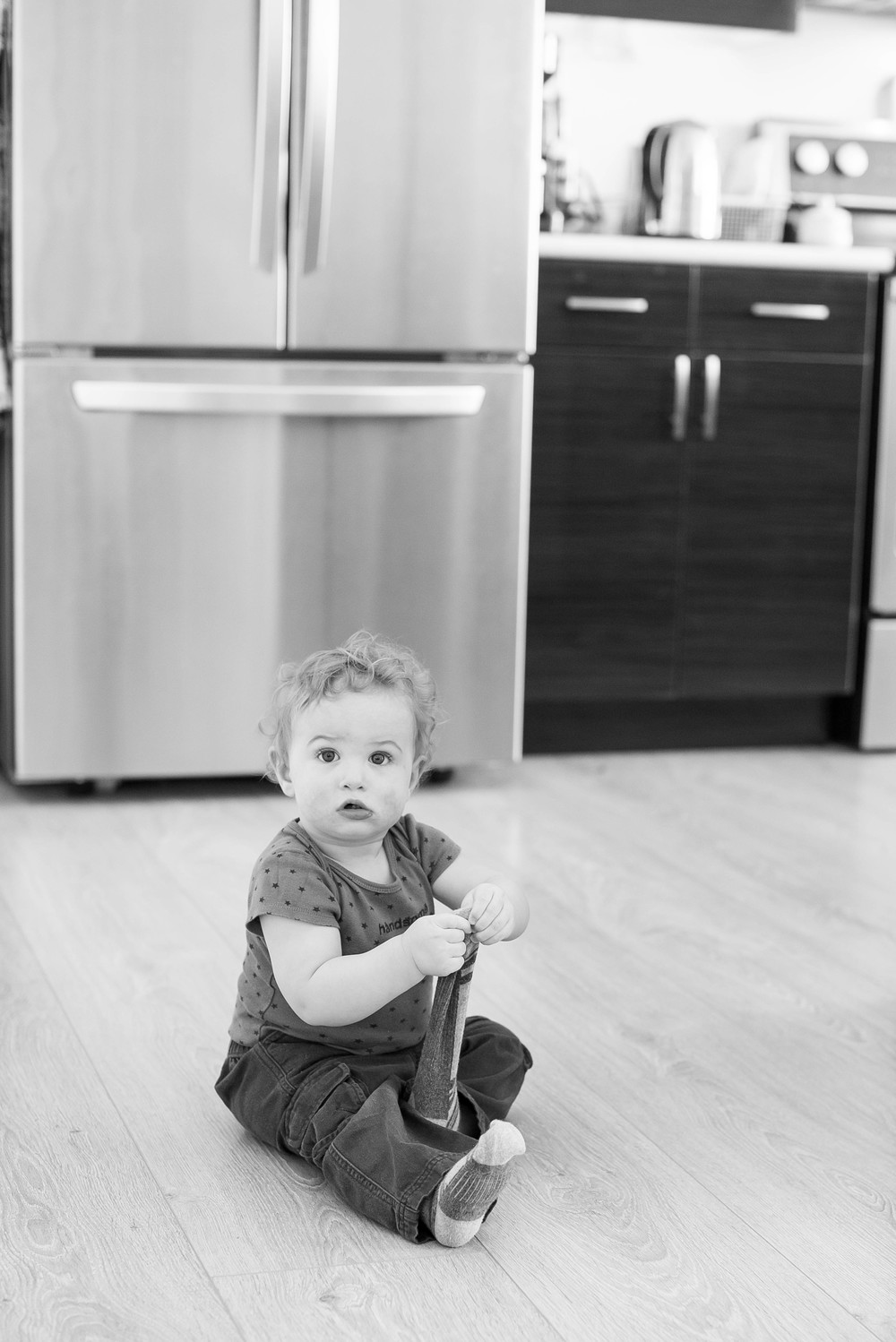 According to Heidi, this is a completely accurate portrayal of how Myles feels about socks... the socks seriously only lasted for like 5 minutes of the photo shoot before he ripped them off his feet!