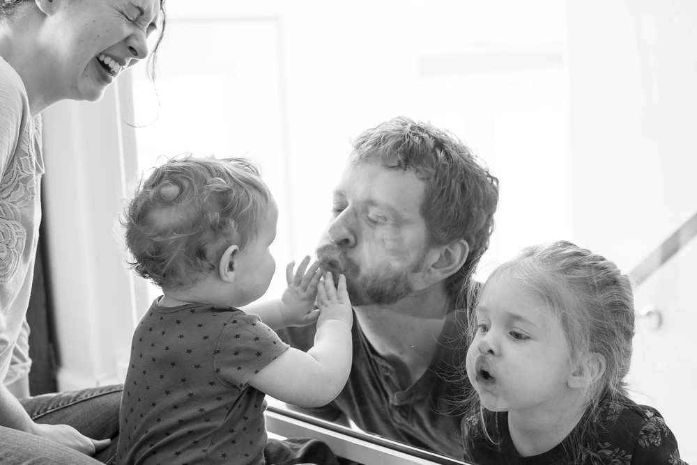 Evan & Heidi have this plexiglass banister that the kids just LOVE to fingerprint. If I'm not mistaken, Daddy is the instigator! You'll have to ask them if you want to see some of the outtakes...