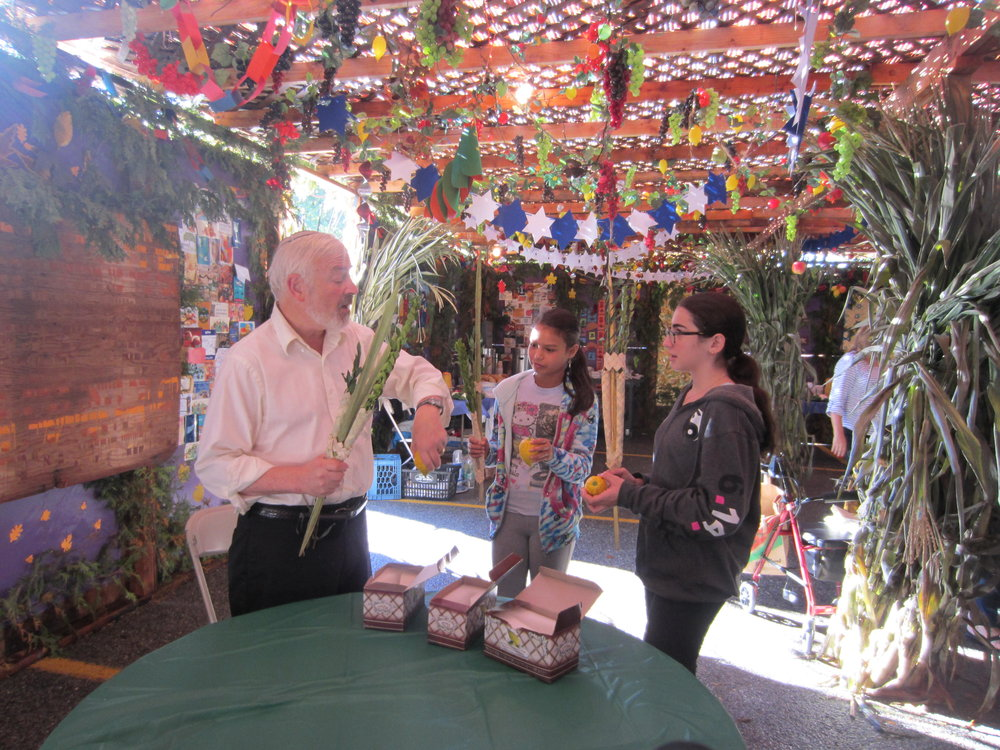 Students in sukkah.JPG