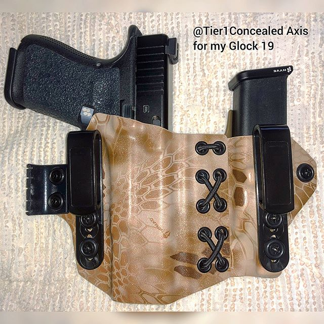 Check out this sick ass holster from @tier1concealed for my #Glock19 #Gen5 in @kryptekoutdoorgroup #Nomad with FDE for the rear. This is by far one of the best holsters I own due to the flex point in the middle. It not only helps conceal very very well, but it makes sure to curve and flex with your body preventing the spare magazine from digging into your gut. I wish more kydex holster makers would learn a thing or two from Tier 1 because that flexpoint is now EVERYTHING to me. I won't buy another holster without it. Gonna have to order a new one cuz I just got a TLR1-HL :) . . . #tier1 #tier1concealed #tier1axis #axis #tier1concealedaxis #mycurrentfavholster #holster #holsters #guns #glock #hyvetechnologies #kryptek #kydex #kydexholster #kydexholsters #kryptekholster