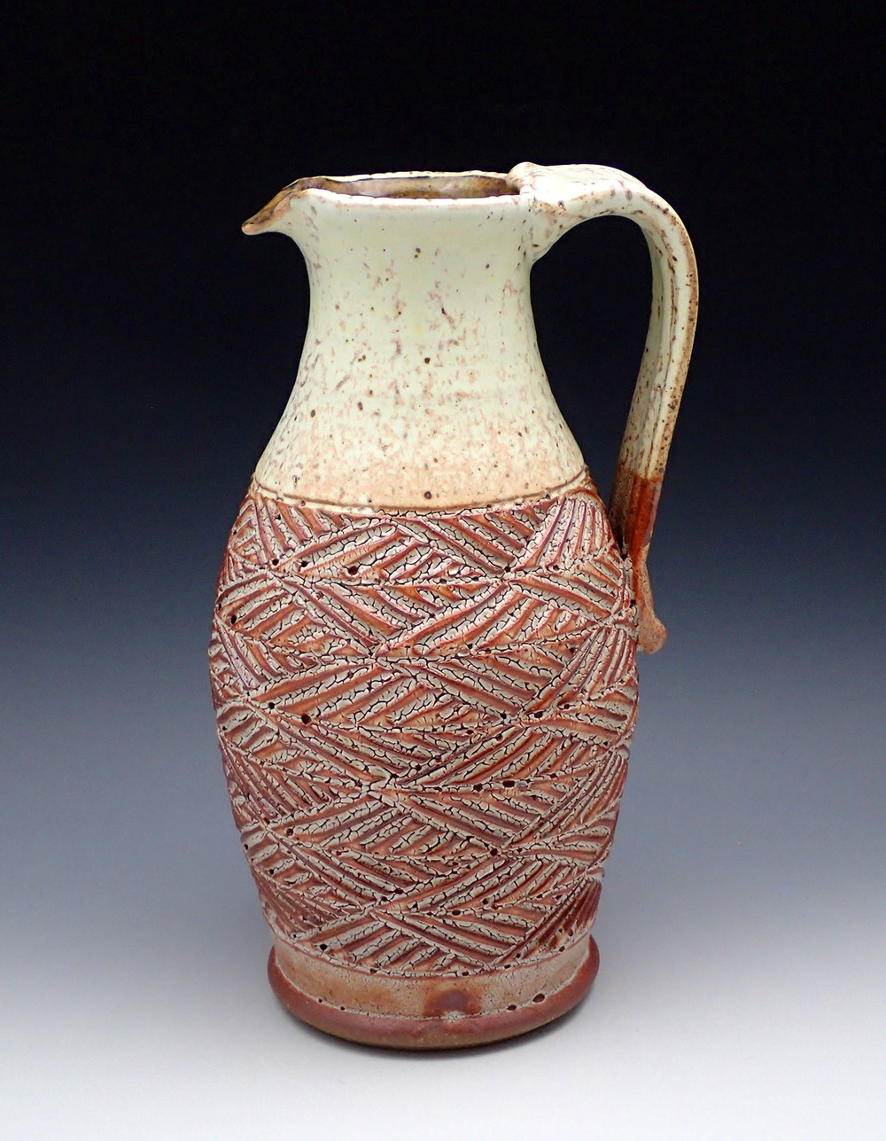 Carved Stoneware Pitcher
