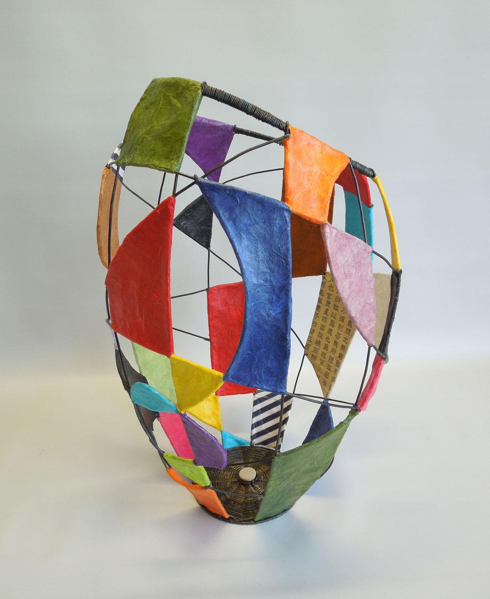 Kaleidoscope Basket- annealed steel, papers