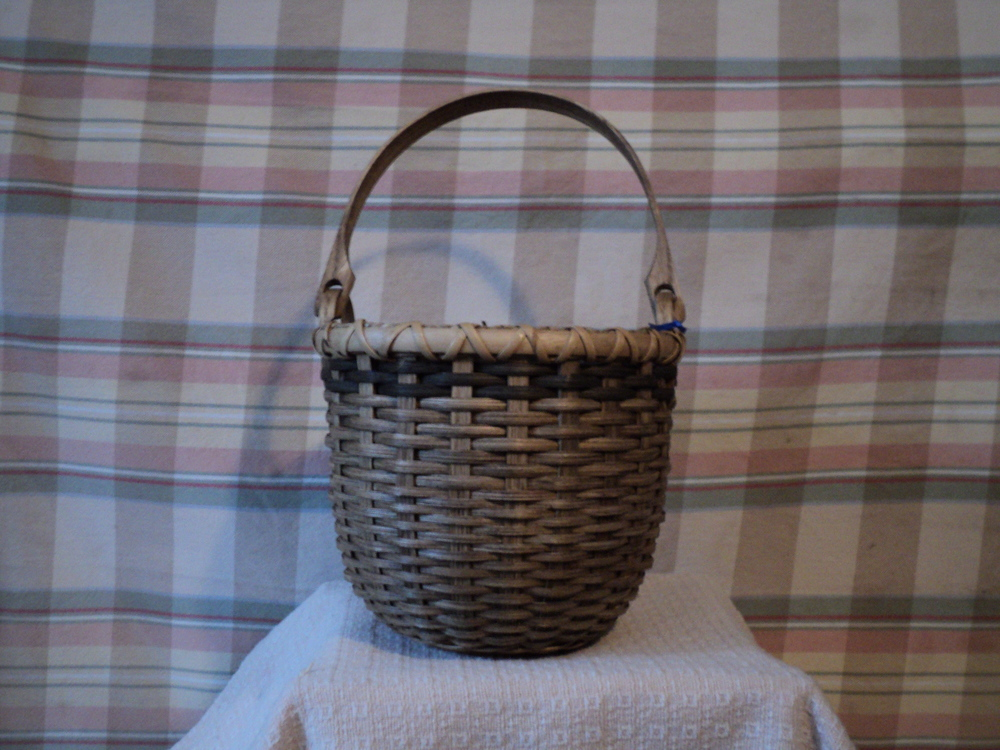 Tall basket with handle