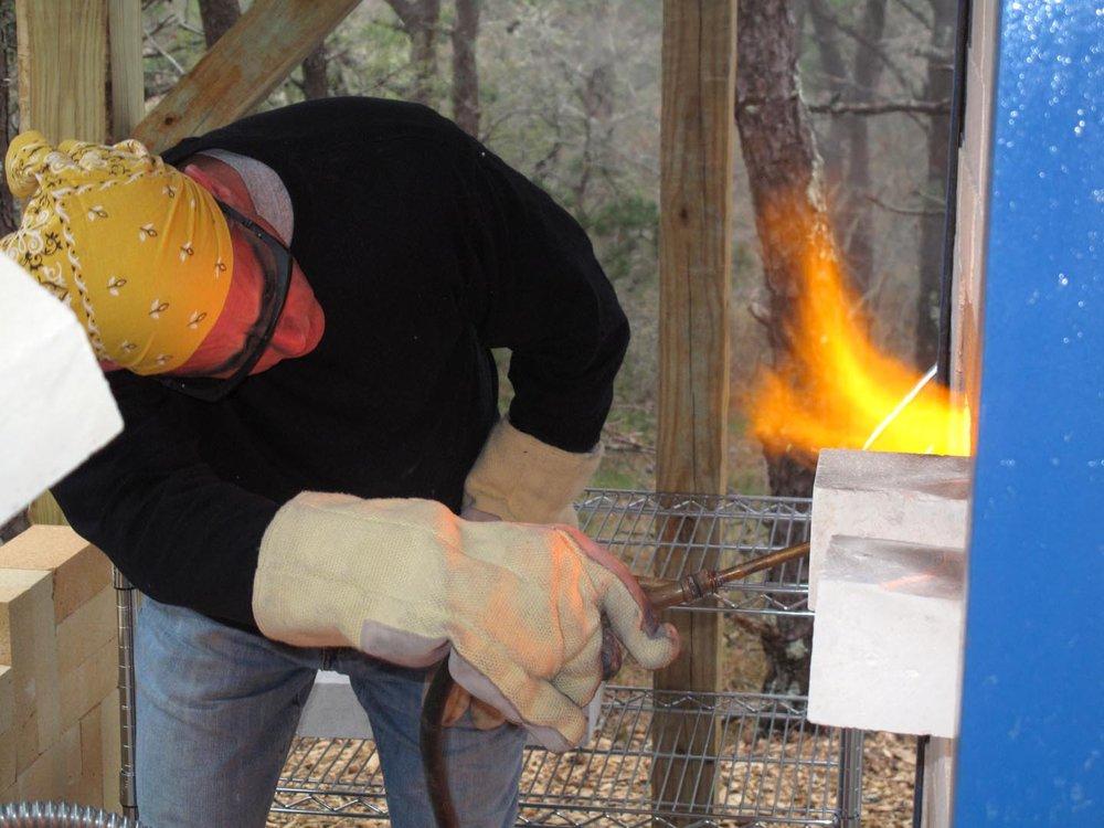 Here I am firing the cross-draft soda kiln.