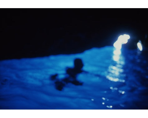[Nan Goldin, Gigi in the blue grotto with light, Capri, 1997]