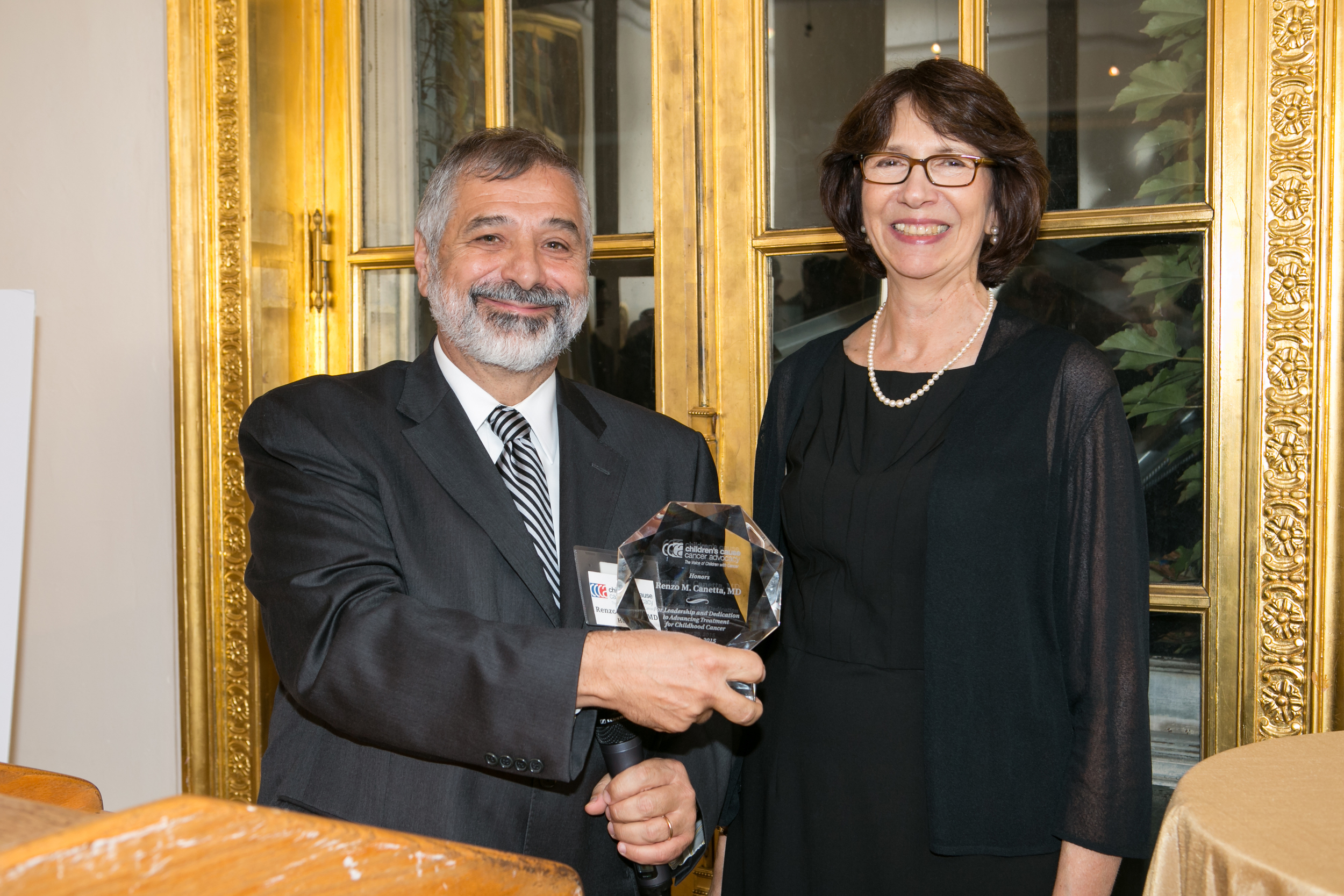 2015 Honoree Renzo Canetta, MD, with CCCA President Susan Weiner, PhD