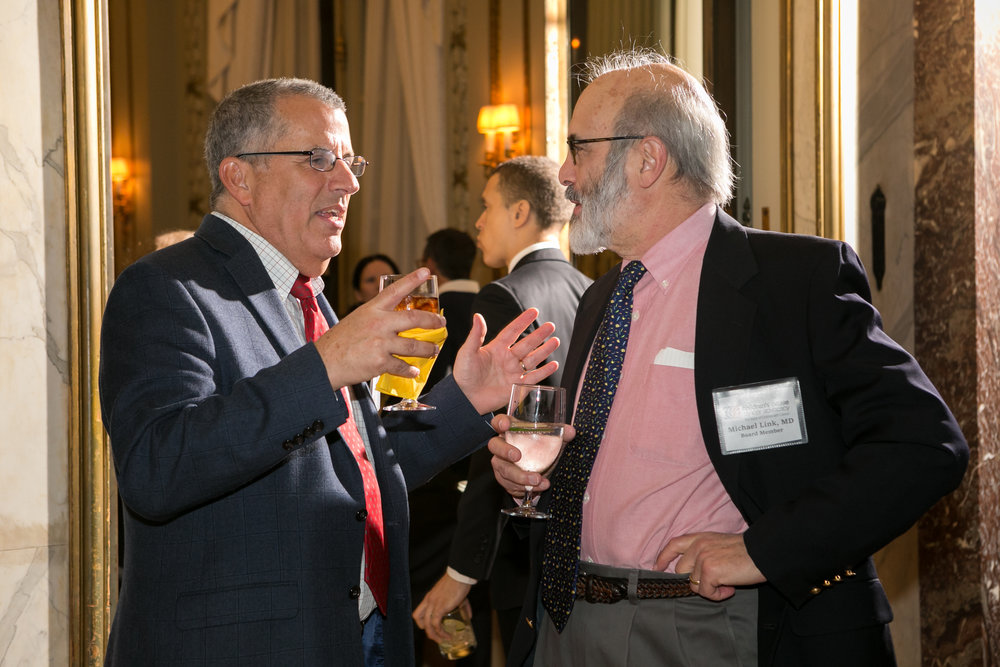 Dr. Peter Adamson speaks to Dr. Michael Link at our New York Reception, 2018. Dr. Link serves on the CCCA Board of Directors.