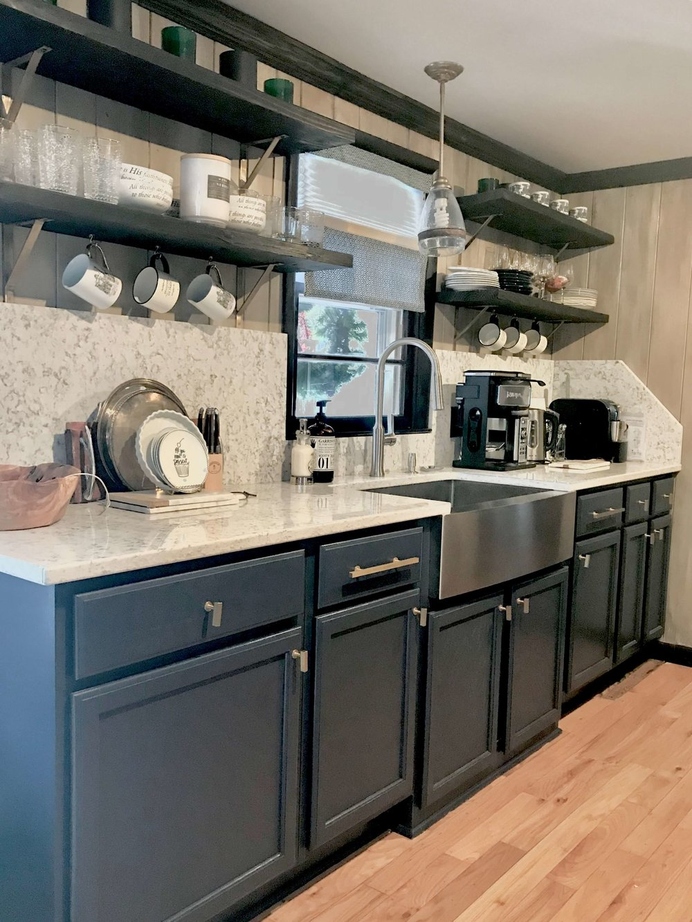A Versatile Farmhouse Sink And Open Shelving.