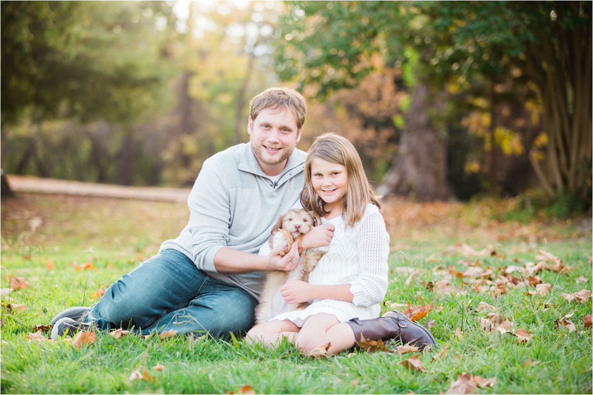 Family portrait shoot with puppy at Vasona Lake Park in Los Gatos, CA. Photos by Briana Calderon Photography based in the San Francisco Bay Area in California.