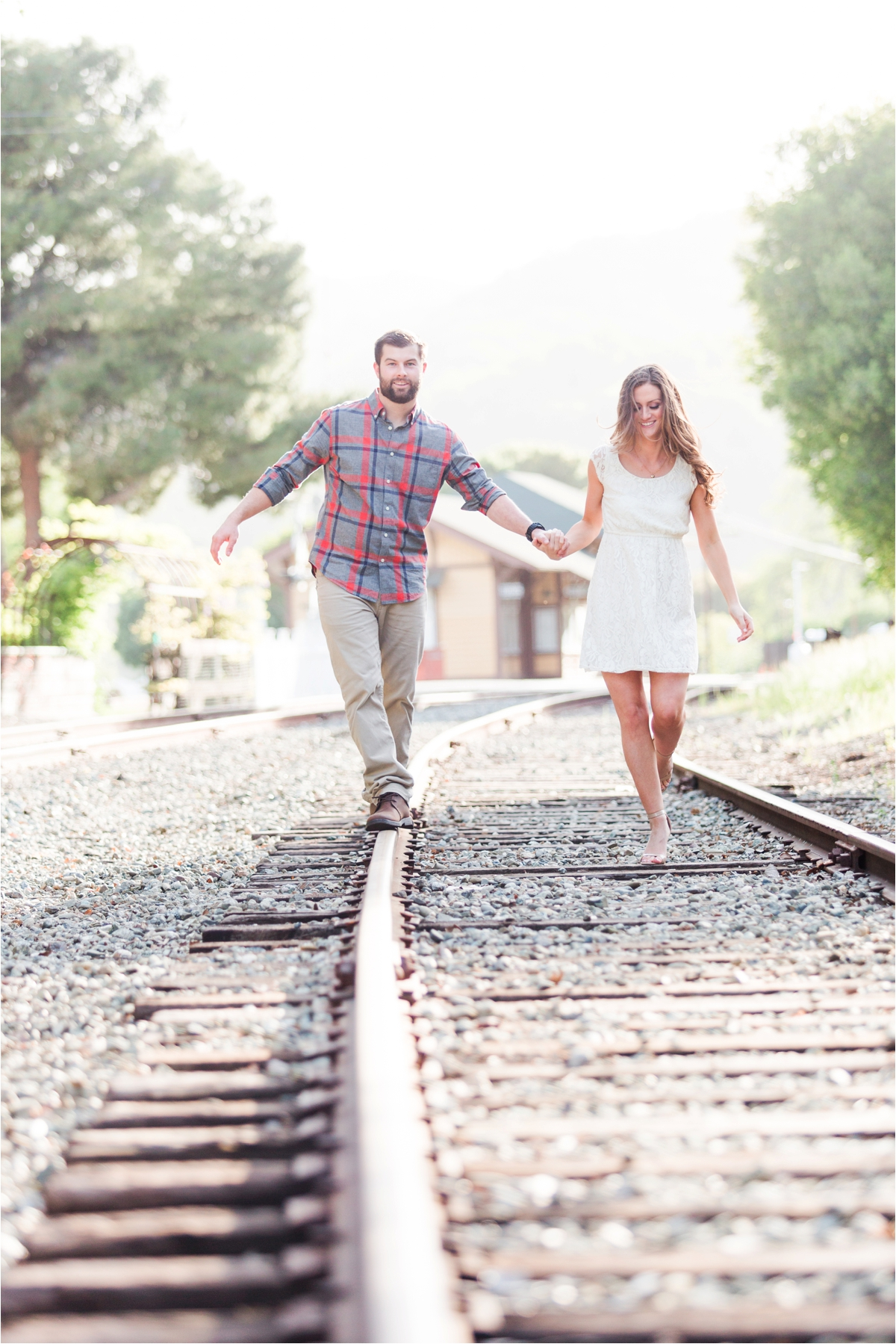 Engagement shoot in downtown Sunol, CA with train tracks and urban graffiti. Photos by Briana Calderon Photography based in San Francisco Bay Area in California.