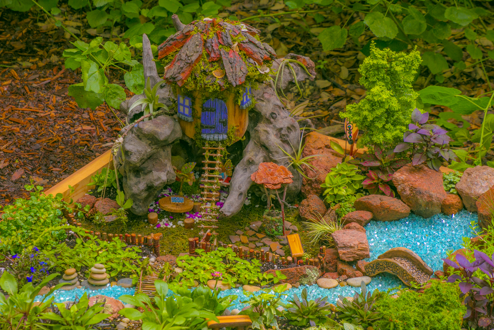 A faerie wishing well, dry river bed and rock sculptures.