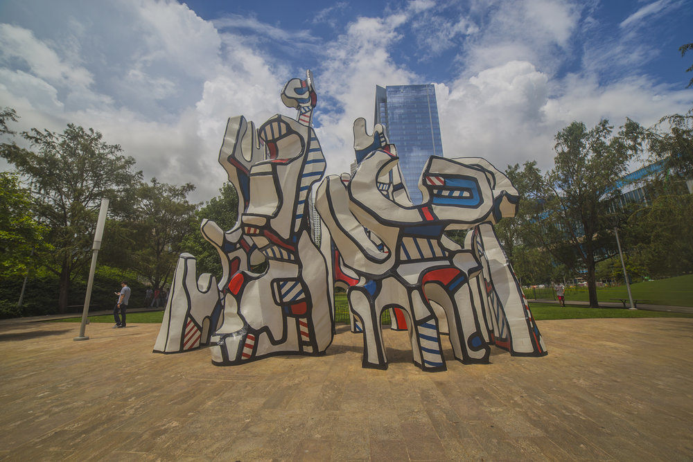 Perhaps the park's most famous public art installation, Monument au Fantome is a 33-foot-tall, free-form red, white and blue structure adjacent to the convention center. Its form and pieces mimic parts of an imaginary city, including a church, a dog and a tree. It was created by Jean Dubuffet, an internationally reknowned French sculptor who passed away in 1985. Photo by Maria Sprow.