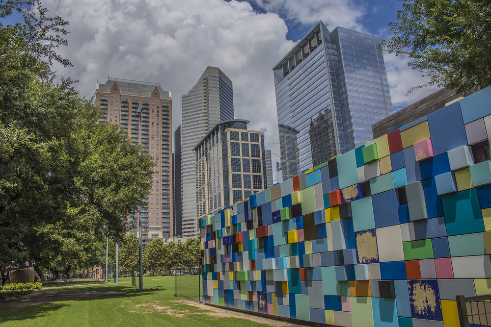 Possibly the most photographed installations in the park, the Synchronicity of Color art boxes were commissioned by the Discovery Green Conservancy to add color to the park and connect the underground parking garage pedestrian entrances to the park. They were designed by Margo Sawyer, an art professor at the University of Texas at Austin who was involved with the park's master planning. Photo by Maria Sprow.