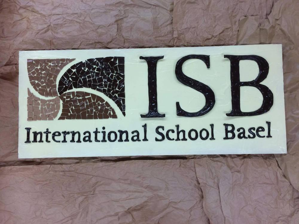 Collaborative project using chocolate mosaic pieces made by students at the International School of Basel, Switzerland to create their school logo from pure chocolate.
