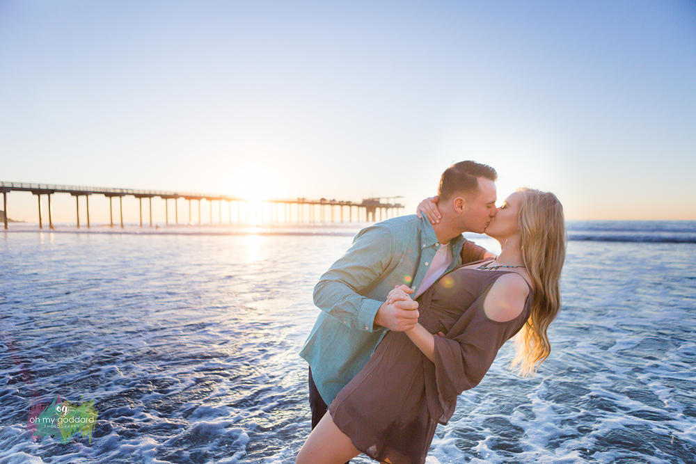 la jolla shores scripps pier kissing sunset engagement.jpg