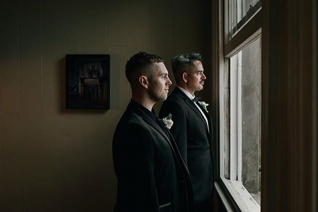 "All I could think of when Kurtis told me he was having a black velvet suit ""tailored to within an inch of its life"" for his wedding to Geremy was - Yes. All the yes and some. ⠀⠀⠀⠀⠀⠀⠀⠀⠀ How good do these two suit up. Dream boats on their wedding day."