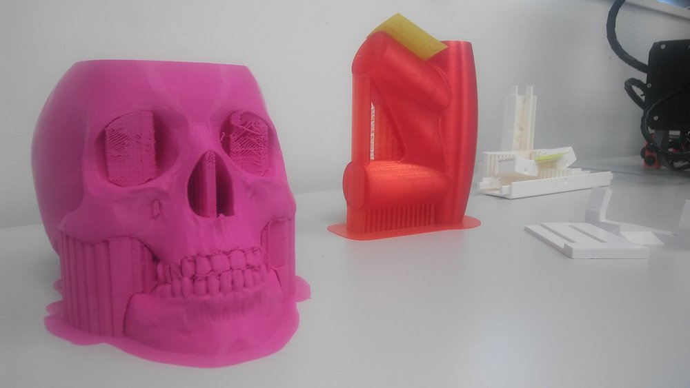 "3d printed skull- the red shape in the back is actually a ""Martian ray gun"" standing on its barrel"