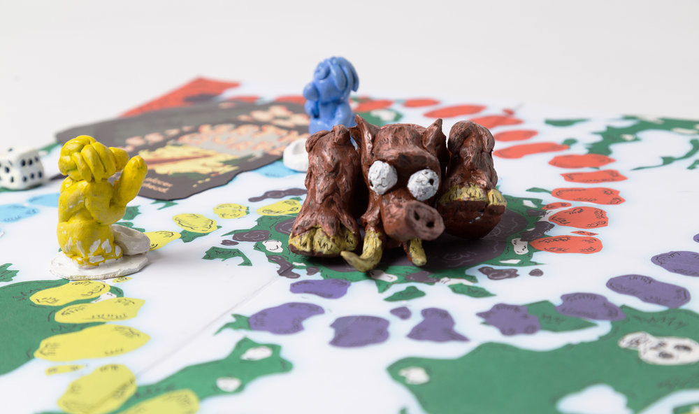 The mammoth is located in the tar pit in the center of the game board. The players first goal is to be the first to reach the mammoth and take a piece of meat.