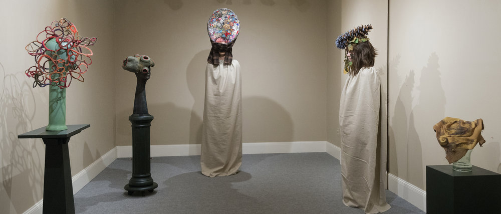 Live performance during opening reception with unidentified women acting as human pedestals.