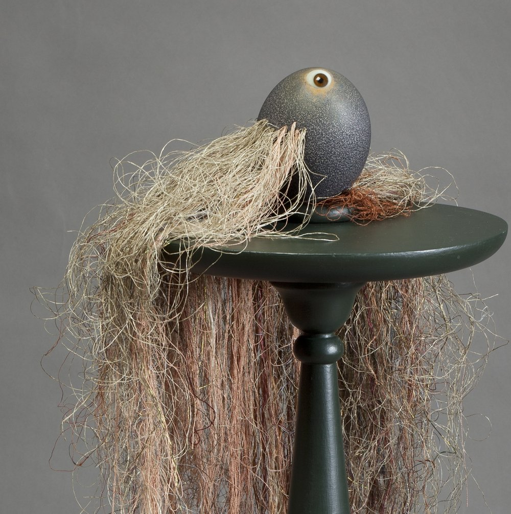 READY OR NOT, 2018, 6x10x29 in., emu egg, mixed threads, human prosthetic eye