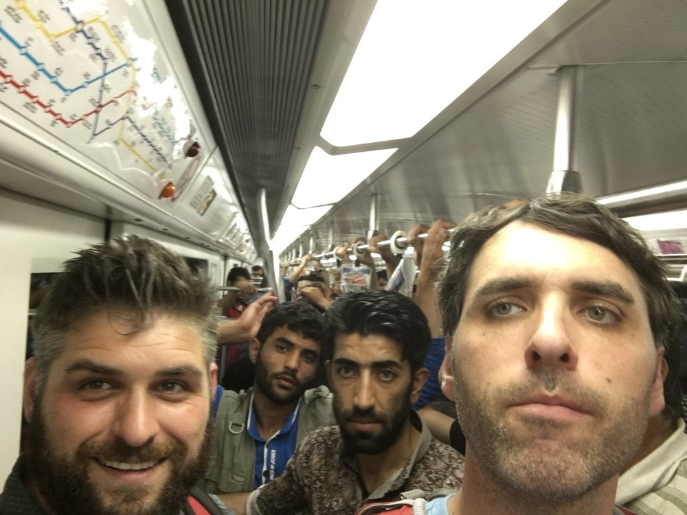 My brother and me riding the subway in Tehran
