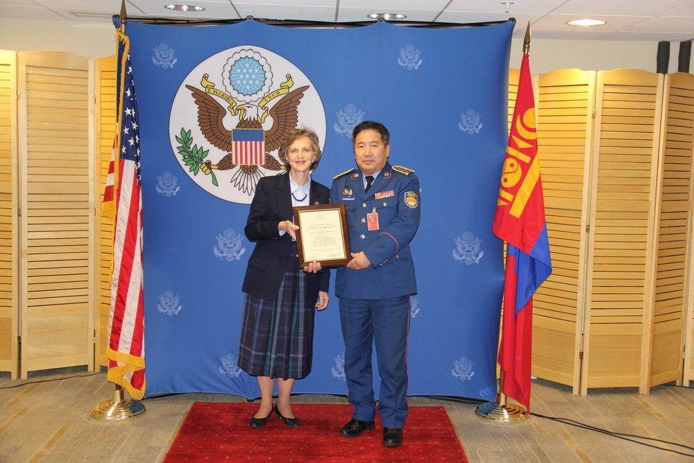 U.S. Ambassador Jennifer Galt thanking the head of Mongolia's National Emergency Management Agency. Photo courtesy of U.S. Embassy, Ulaanbaatar, Mongolia