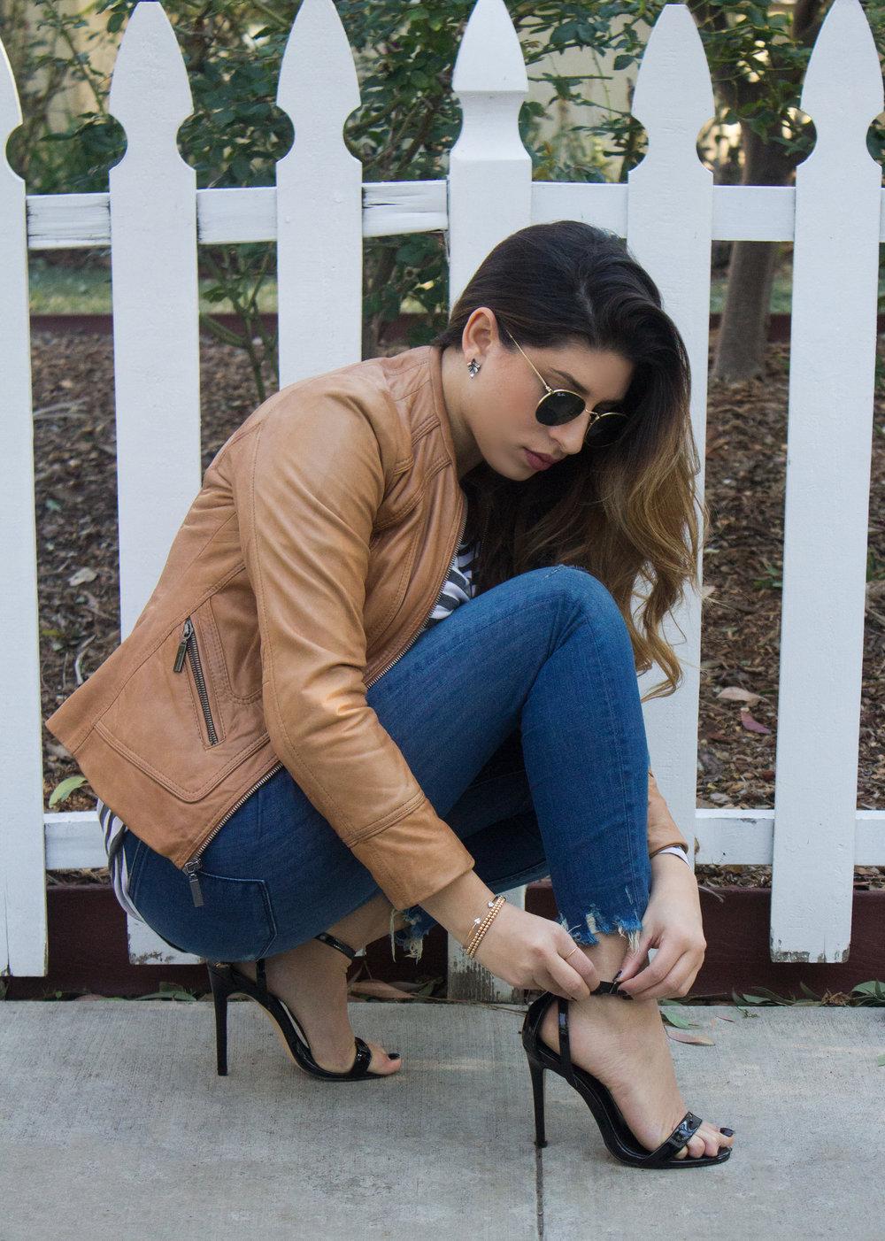mel-ronnie-camel-leather-jacket-stripes-black-celine-envelope-clutch-patent-sandals-frayed-hem-jeans-round-sunglasses-6.jpg