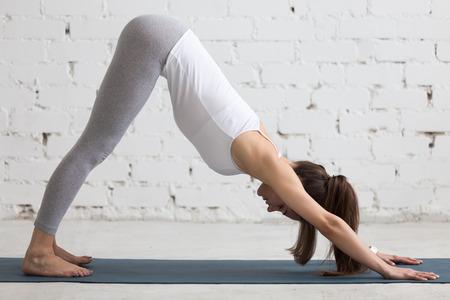 52721992_S_Downward_dog_yoga_woman.jpg