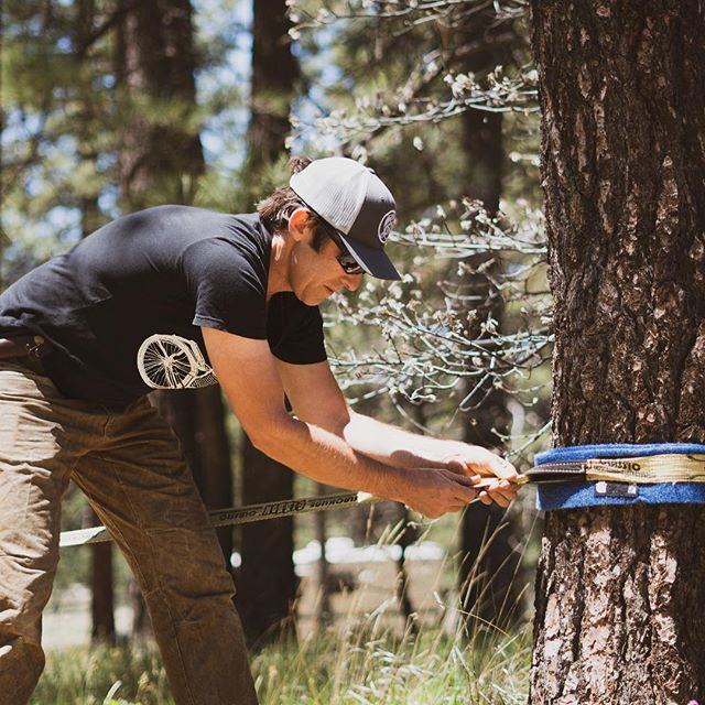 A slack line is tons of fun and great for your balance and core.  #sackline #camping #trees
