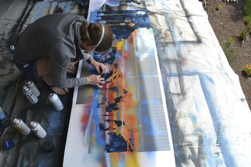 Artist Nichole McDaniel creating a piece of Heisler Park, Laguna Beach, California