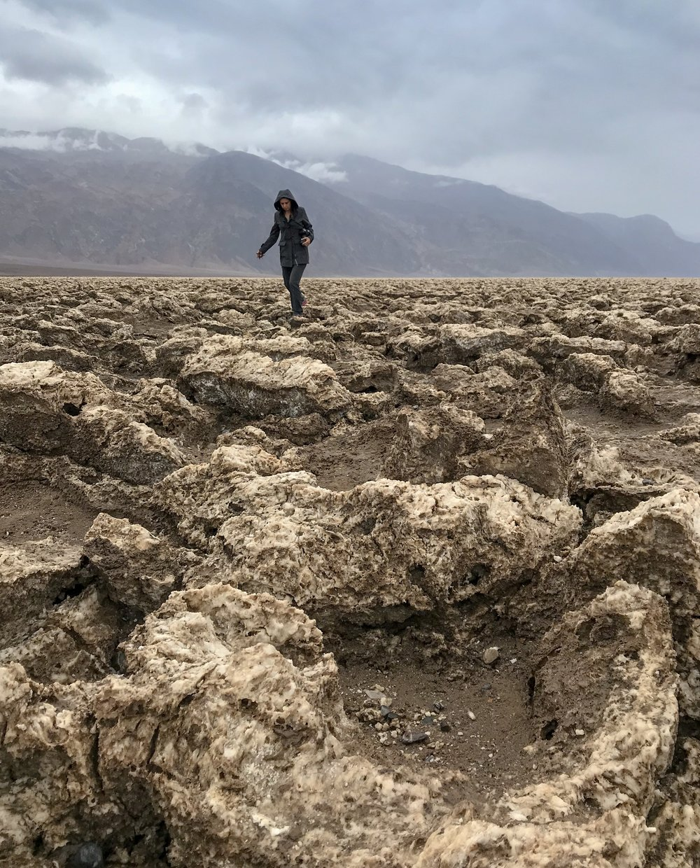 Walking among the salt and rock formations at Devil's Golf Course, Death Valley National Park